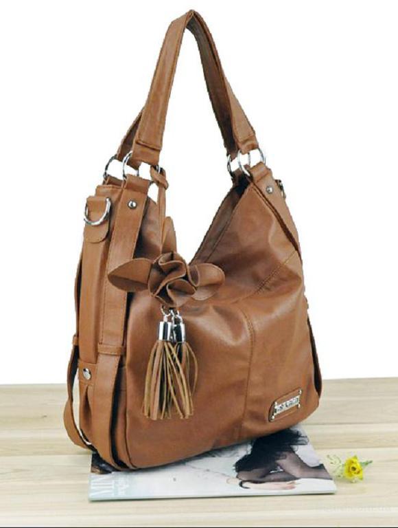 Женская сумка коричневого фото.