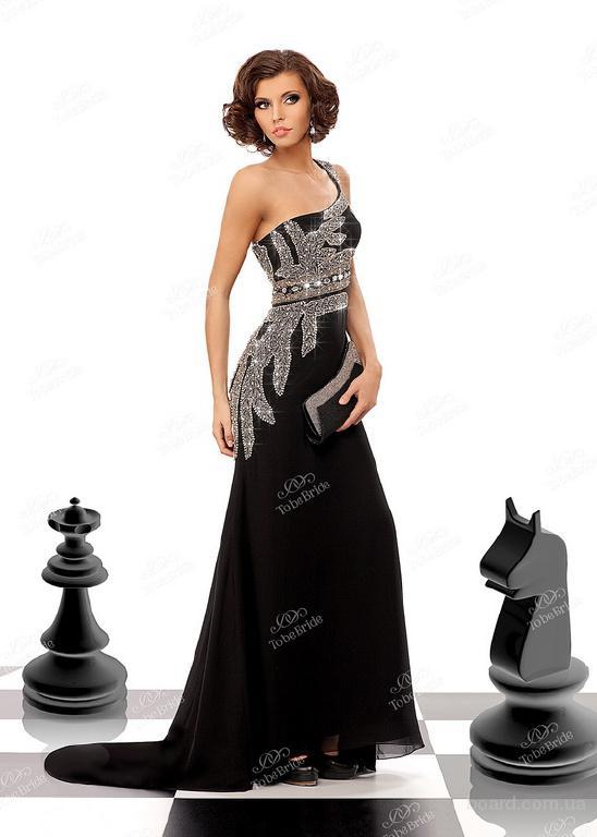 Сток вечерних платьев оптом